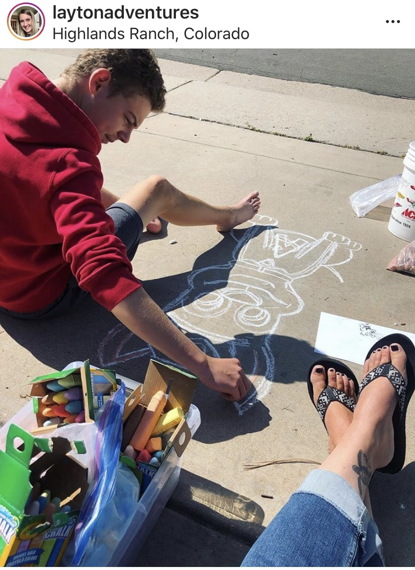 Chalking a 'thank you' message on our driveway for a 2yr old fan who checks our driveway every morning for a new picture. What raising an artist looks like.