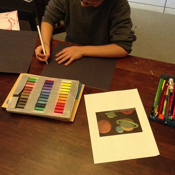 Enjoying chalk pastel art in space lessons to match Apologia astronomy.